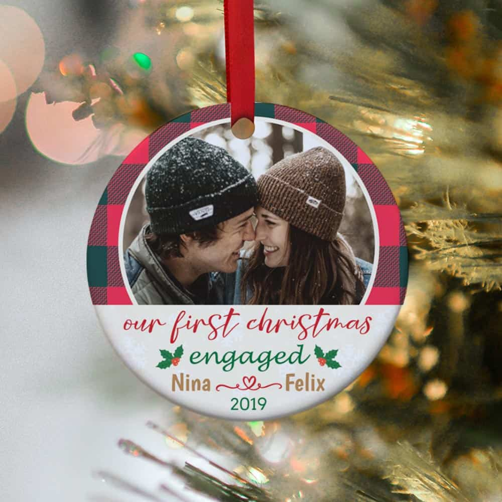 a photo ornament with the word Our First Christmas Engaged
