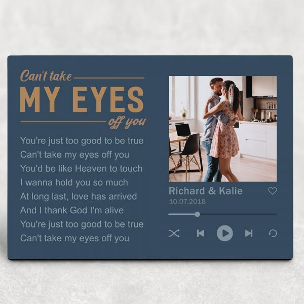 a desktop photo plaque with song lyrics Can't Take My Eyes Off You