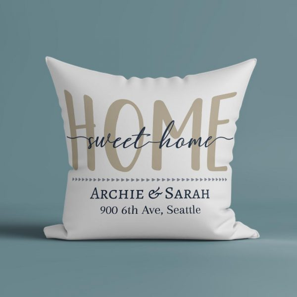 a custom pillow with the quote home sweet home and personalized address