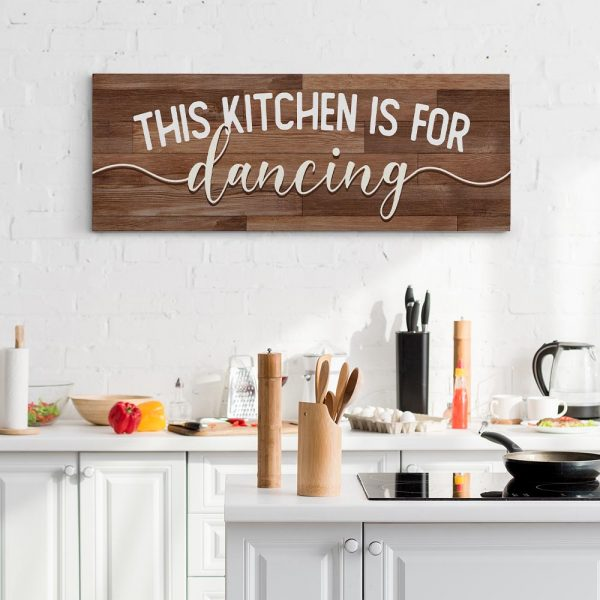 a canvas print with the quote this kitchen is for dancing