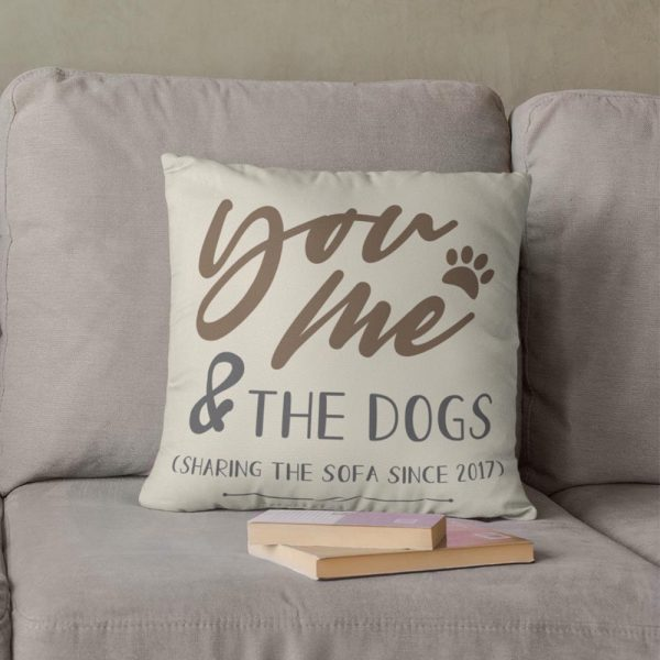 The You Me And The Dogs Custom Suede Pillow resting on a couch as a housewarming gift