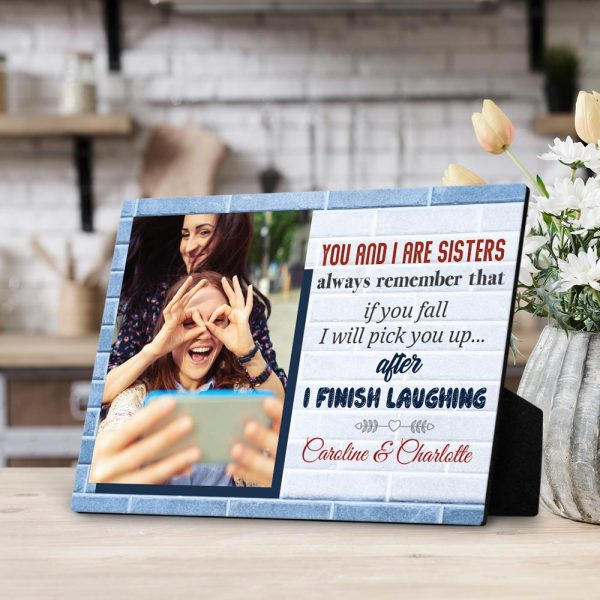 a desktop photo plaque with a funny quote that says Sisters If You Fall I Will Pick You Up After I Finish Laughing